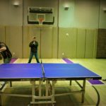 Tim Tebow playing table tennis with JOOLA's Trevor Runyan