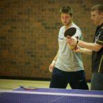 JOOLA's Trevor Runyan teaching Tim Tebow how to do a proper table tennis backhand