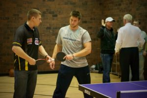 JOOLA's Trevor Runyan teaching Tim Tebow how to do a proper table tennis backhand